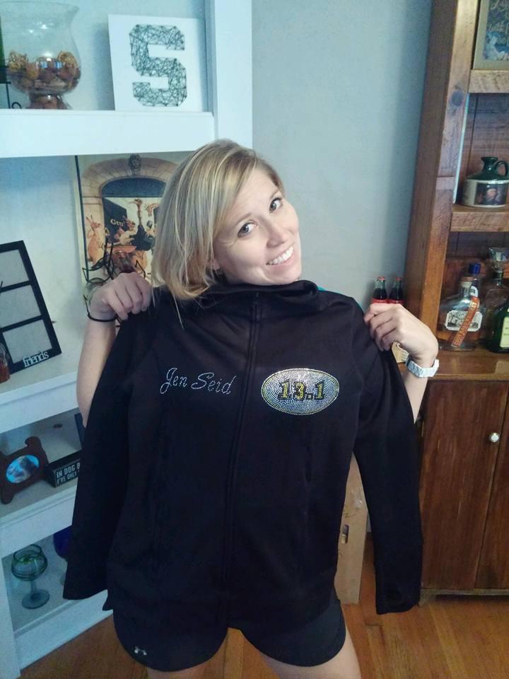 Jen holding up her new jacket.