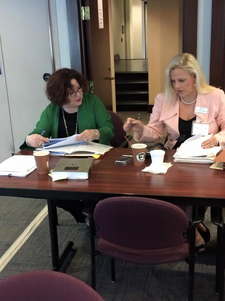 Elizabeth Hubbard and Wendy Robbins sitting at the table preparing for the seminar.