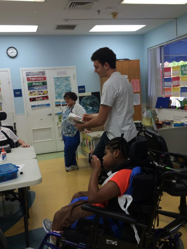 Max reading his book to the children at Broward Children's Center.