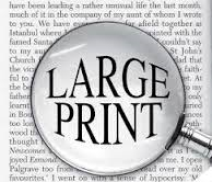 a magnifying glass that shows the words large print being magnified on a page out of a book.