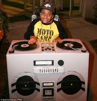 a young man with a Halloween costume that turned his wheelchair into a DJ station with turn tables and speakers