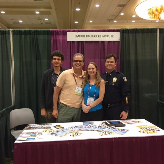 Max, Matt, Debbie, and Lt. Barta at the DIG booth at the ASA conference.