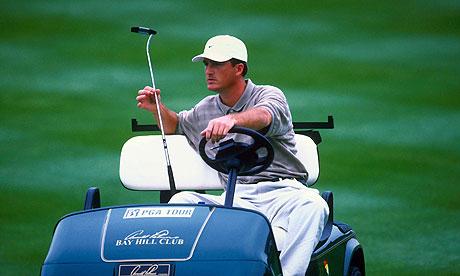 Casey Martin in a golf cart.