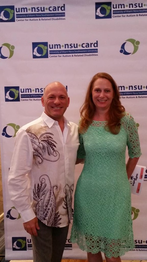 Debbie Dietz posing with another particpant at the UM-NSU CARD (University of Miami-Nova Southeastern University Center for Autism and Related Disabilities) ceremony