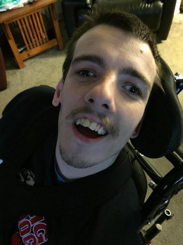 Nick smiling up at the camera