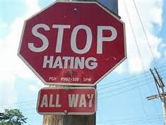 stop sign that says stop hating all way