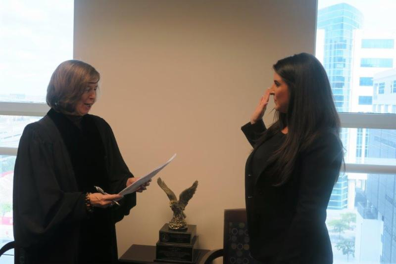 Lisa being sworn in by Judge Muir.
