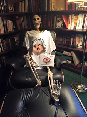 Red Skeleton wearing a penguins t-shirt and holding a copy of the book.