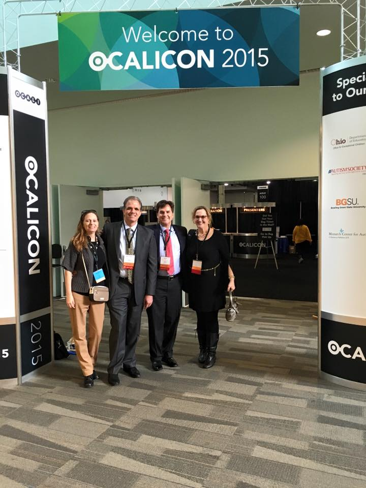 Debbie, Matt, Bart, and Diane standing under a sign that says Ocalicon 2015