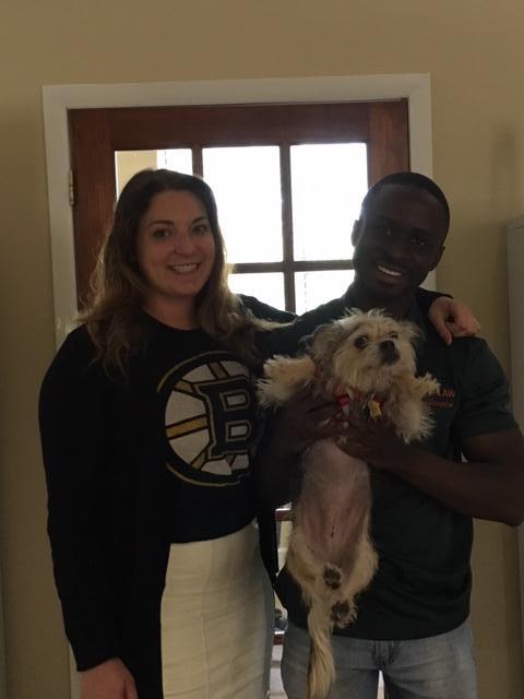 Interns Nardo and Victoria holding Murphee the dog