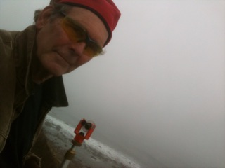 Ned Phillips on location on Block Island Bluffs, doing survey work.