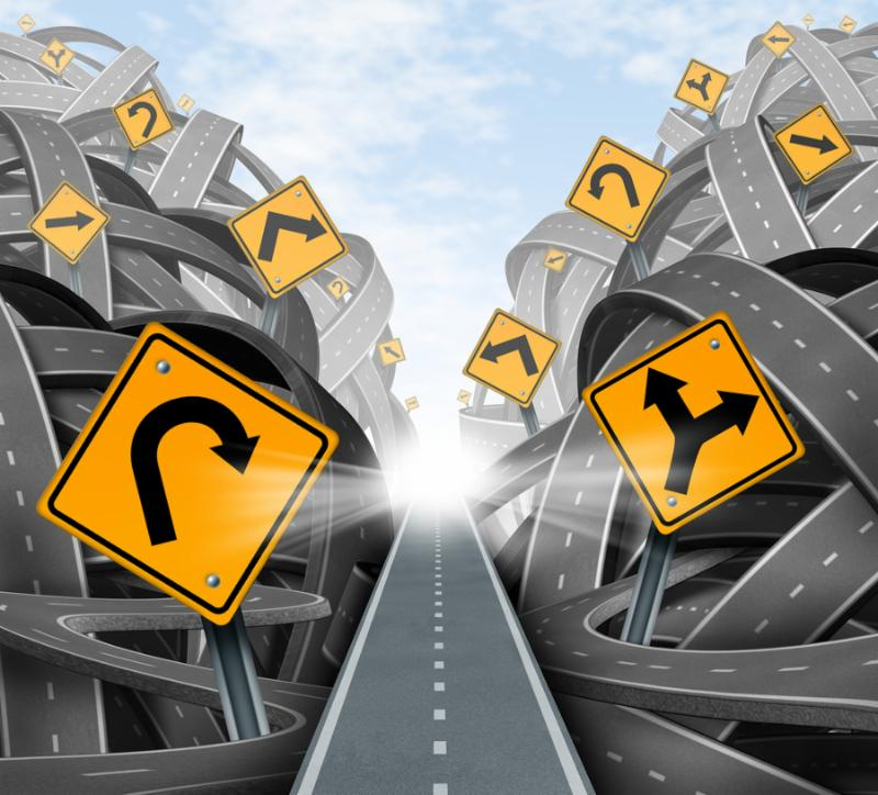 Clear strategic solution for business leadership with a straight path to success choosing the right strategy path with yellow traffic signs cutting through a maze of tangled roads and highways.