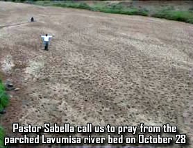 Pastor in dry riverbed