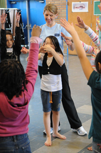 PNB teaching artist Suzanne Singla with 3rd grade students from Graham Hill Elementary (Photo by Bill Mohn)