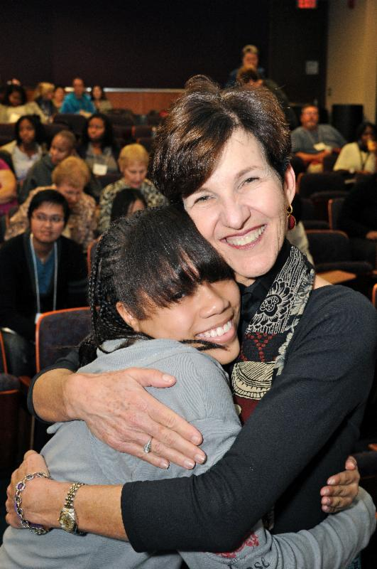 Cindy gets a hug from one of the participants following her speech