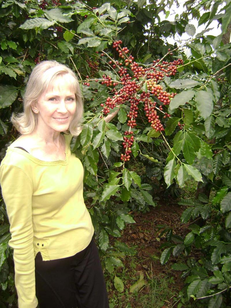 Cathy with a coffee plant