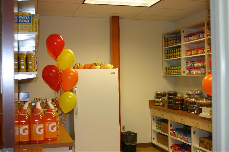 families enjoy the opening of puma food pantry met clubs and