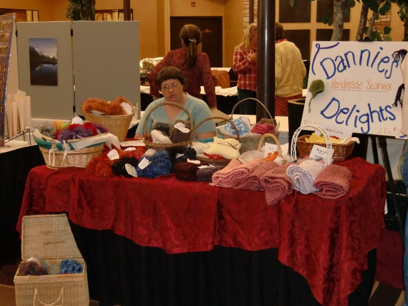 Danielle at a table selling scarves
