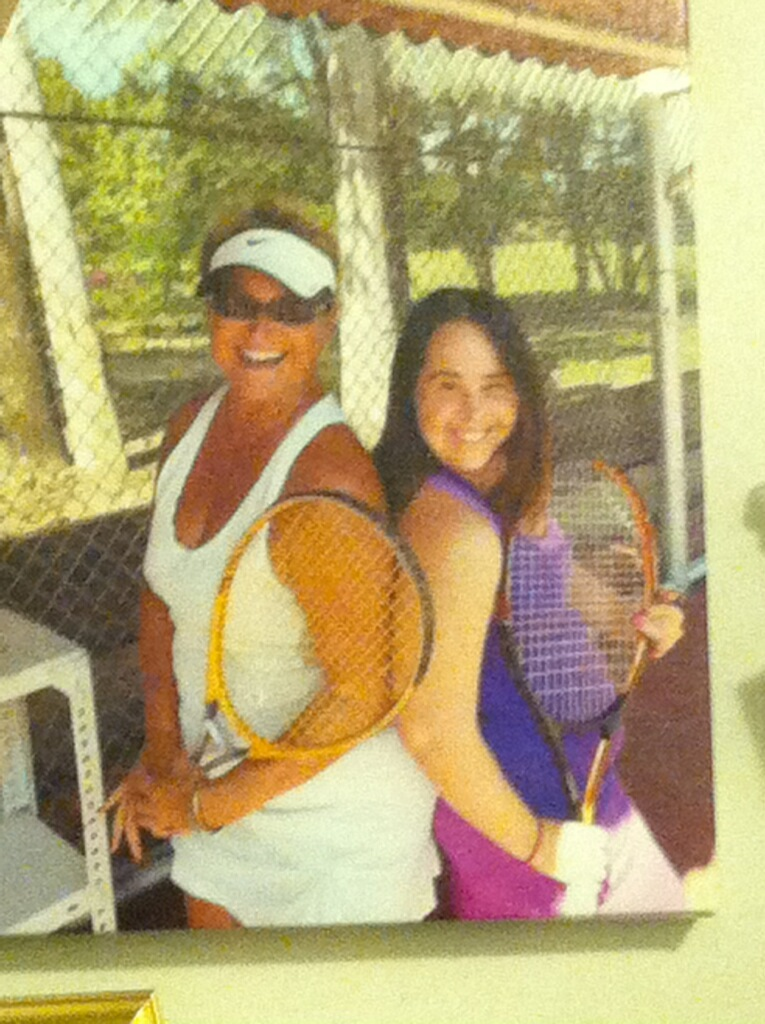 Photo of Molly and tennis coach