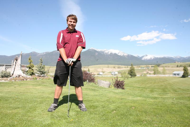 Allen and his golf club on the golf course