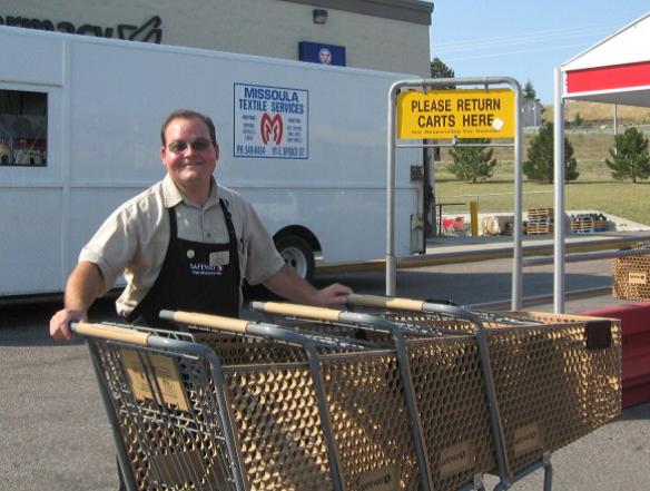 Michael corraling carts in Safeway parking lot