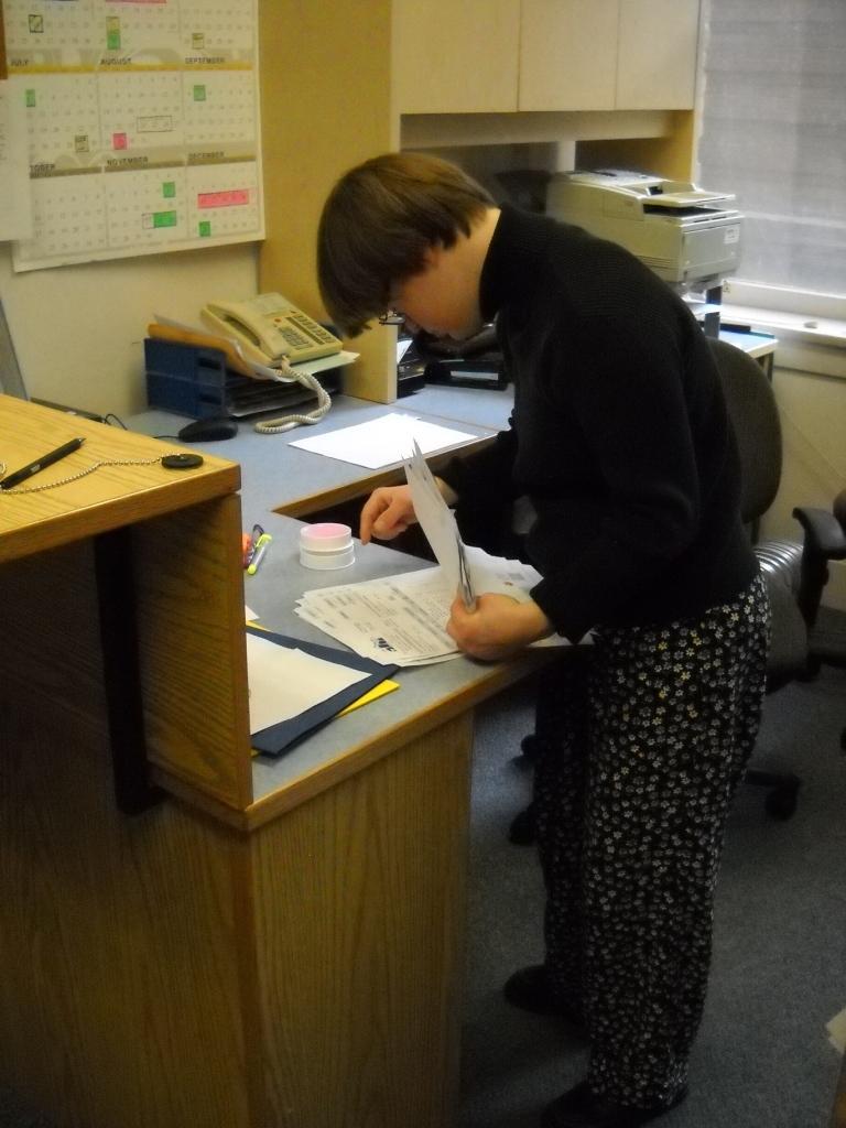 Mathalia alphabetizing invoices