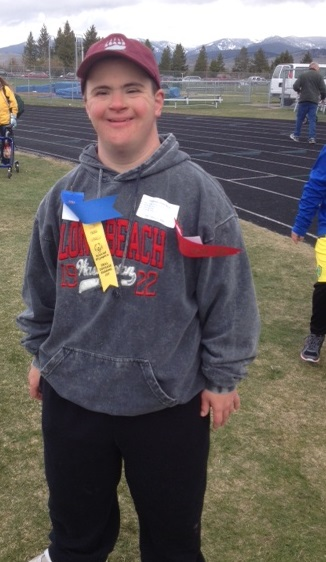 Nate standing smiling and wearing his ribbons