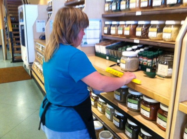 Alyssa facing grocery store shelves