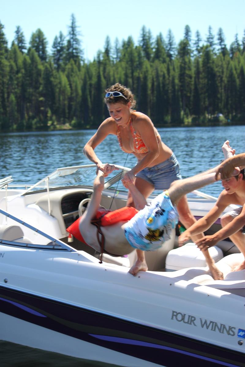 Devin's family tossing him into the water from their boat