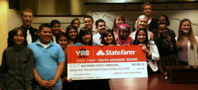 Multnomah Youth Commissioners their $99,000 grant check awarded to them by State Farm
