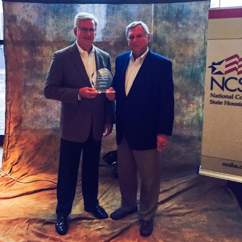 King & Strickland accept NCSHA award for AHBI