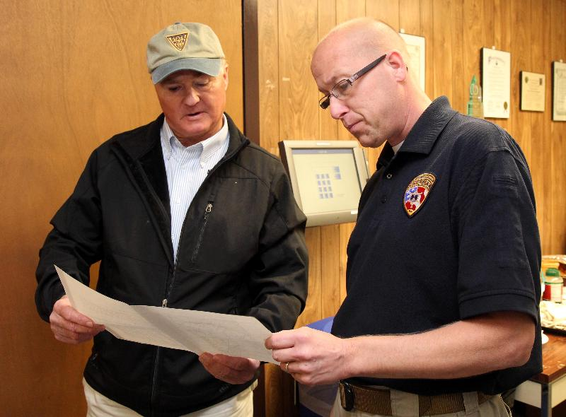 Freeholder Director John P. Curley reviews plans with OEM Coordinator Mike Oppegaard