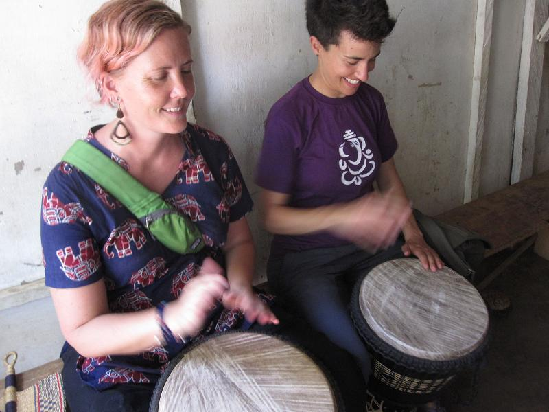Maggie and Katie get a drumming lesson.  Accra, Ghana