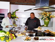 Councilor Michael Thompson cooks with Chef Selwyn Richards