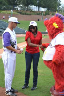 Candrice Nelson throws the first pitch at the July 22 game at the Dash