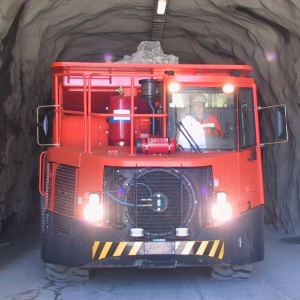 Worker driving mining equipment