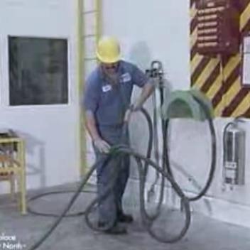 Worker putting hose away to prevent trip hazard