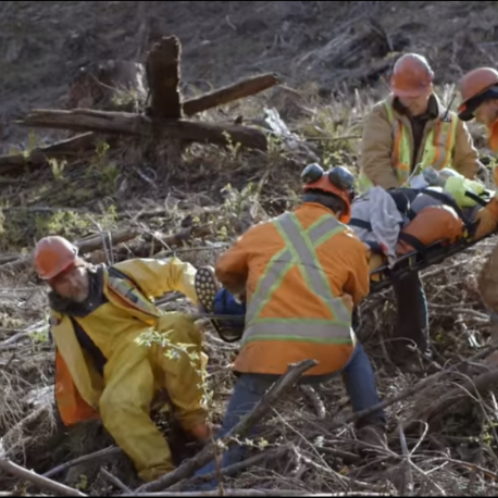 Outdoor workers carrying stretcher