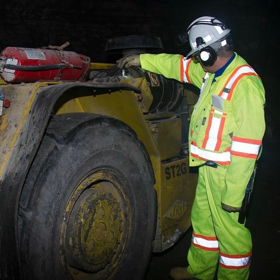 Underground miner and tram