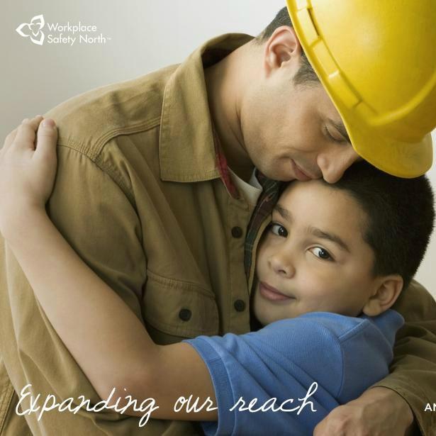Worker hugging child