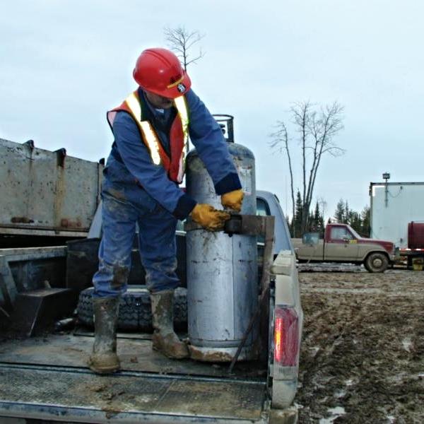 Worker handling propane cylinder