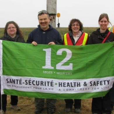 Workers pose with safety award
