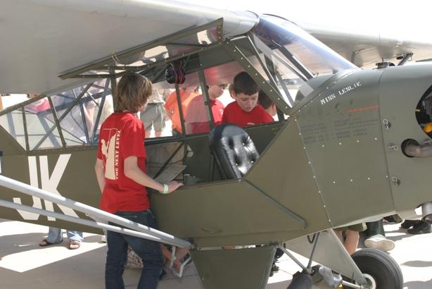 Boys Look Into Aircraft