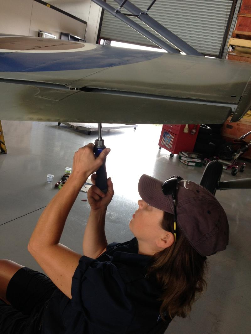Andrea working under starboard wing Spit
