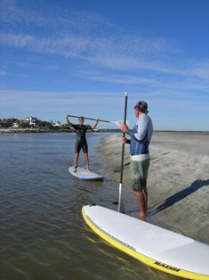 Sandy and David review SUP basics before session