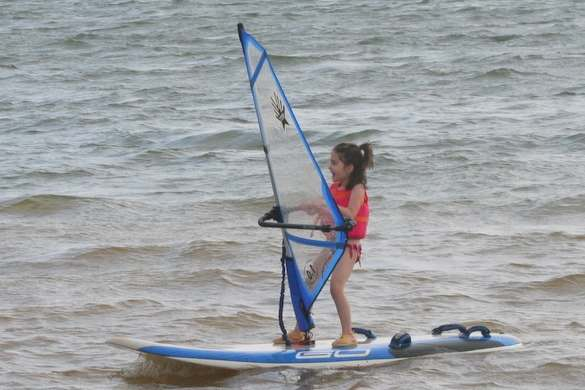 Emmy Andrews, 6 yrs. old, sails a 1.0