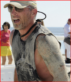 sand man at the finish line