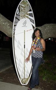 Lori Hurley with her raffle win - Fantaic 9' surf SUP!