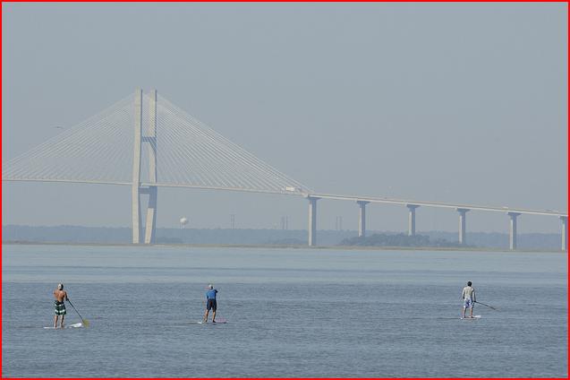 racers with Golden Isles suspension bridge in background