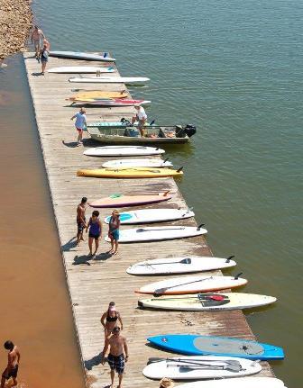 dock full of SUPs at Lake Lanier SPLASH race